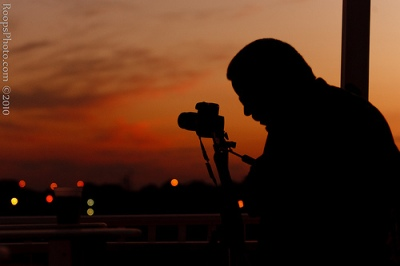 Silhouette of photographer capturing the sunset